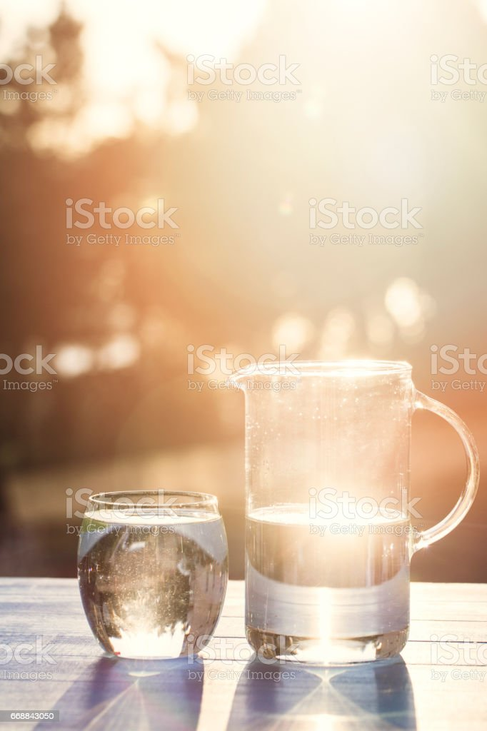 Pouring Water From Pitcher Into Glass – Foto