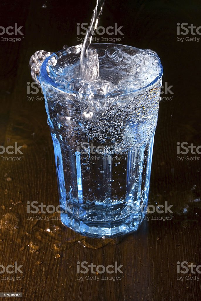 Pouring water into a glass royalty-free stock photo