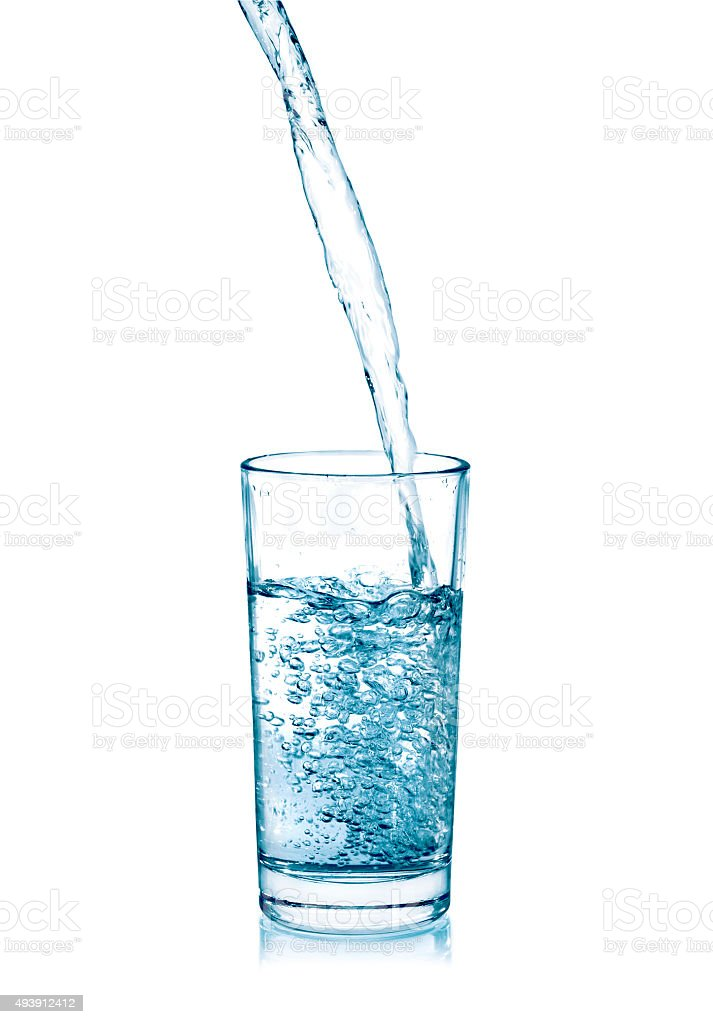 pouring water on a glass stock photo