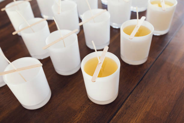 Pouring Wax Into Candle Jars - Candle Making Process stock photo