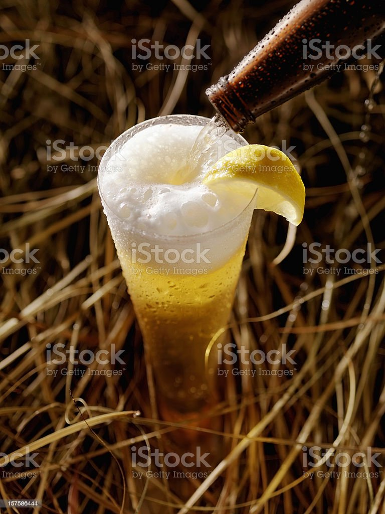 Pouring Wheat Ale Beer royalty-free stock photo