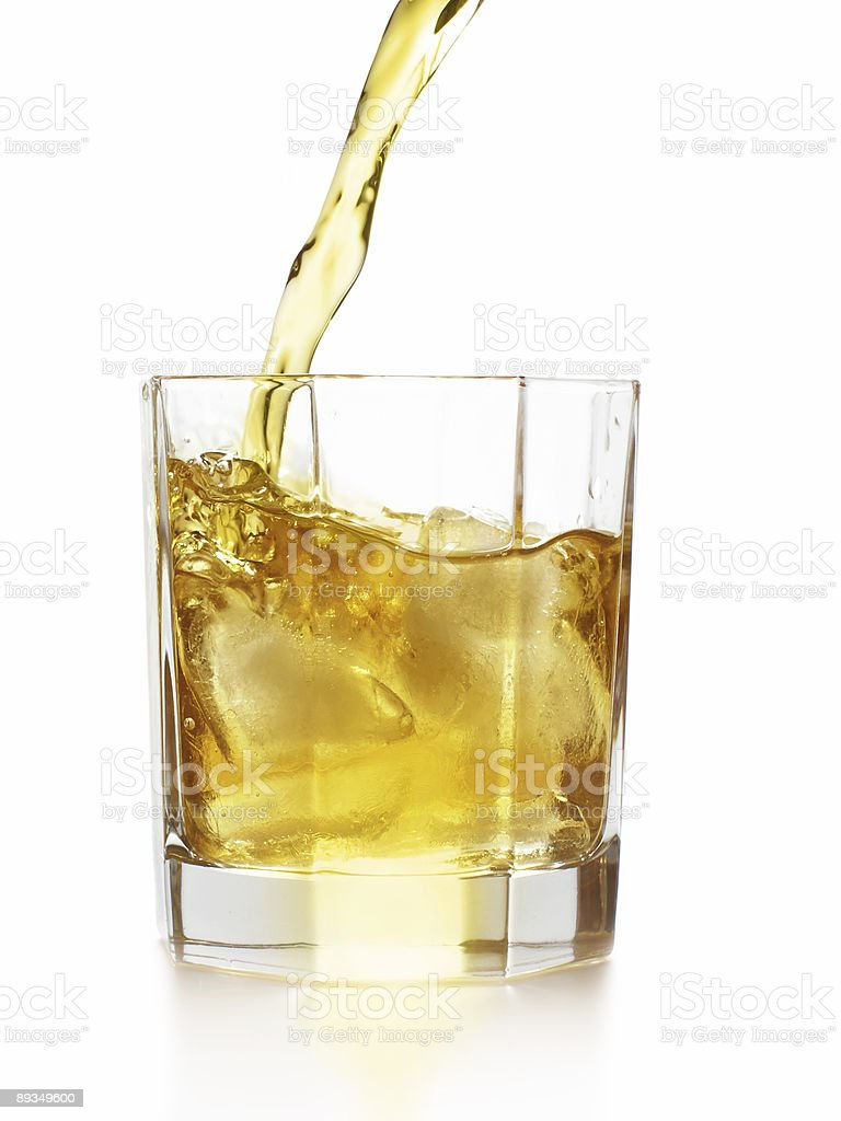 Pouring whiskey stock photo