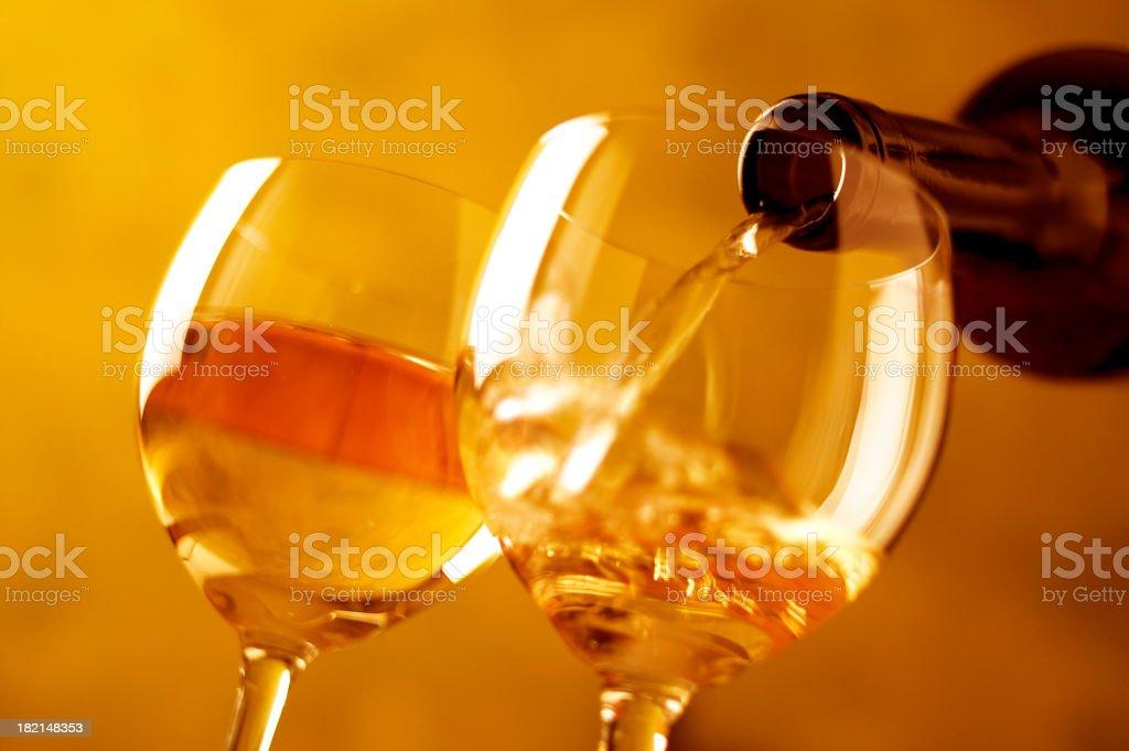 pouring white wine royalty-free stock photo