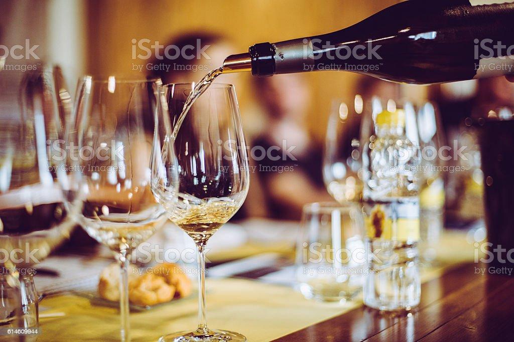 Pouring White Wine stock photo