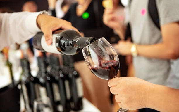 Pouring wine at a party stock photo