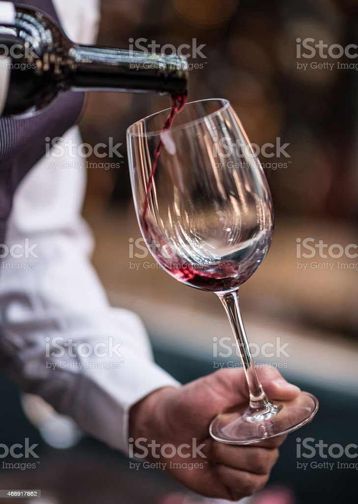 Pouring wine at a winetaste stock photo