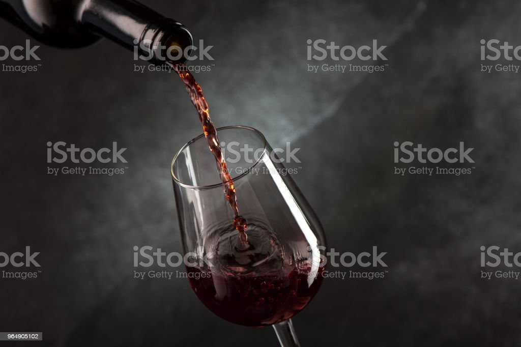 Pouring wine from bottle to glass royalty-free stock photo