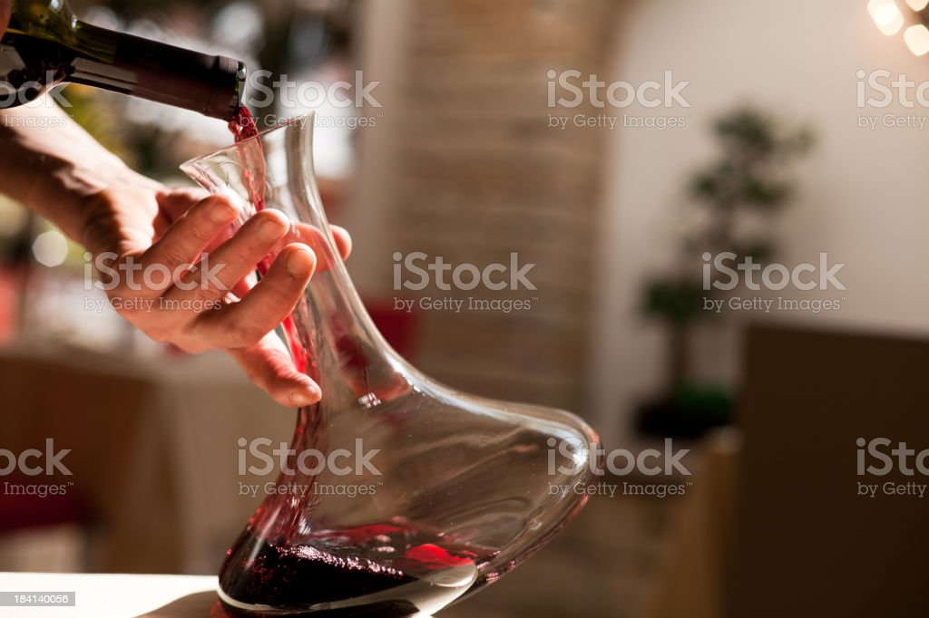 Pouring Wine from the Bottle stock photo