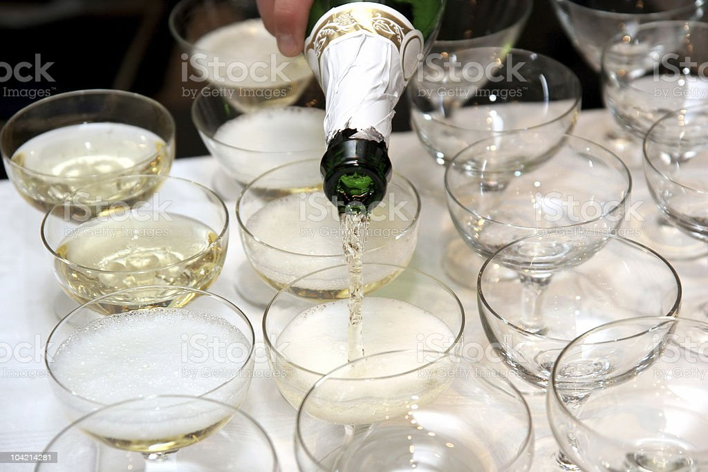 pouring wine in cup royalty-free stock photo