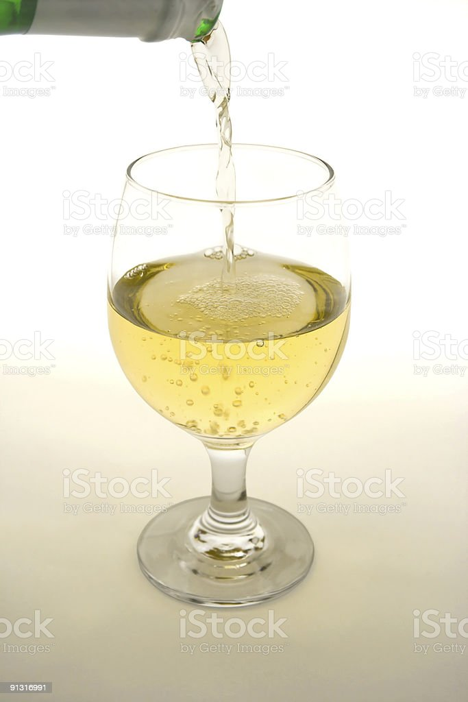 Pouring wine into wineglass royalty-free stock photo