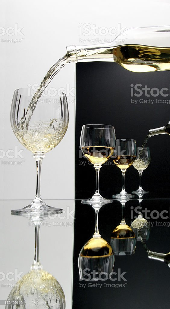 Pouring Wine on White and Black Background stock photo