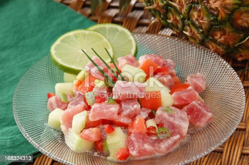 Poisson Cru à la Tahitienne (or E'ia Ota) – the unofficial national dish of French Polynesia –consists of raw ahi tuna tossed with coconut milk, lime, cucumbers, tomatoes, and scallions.