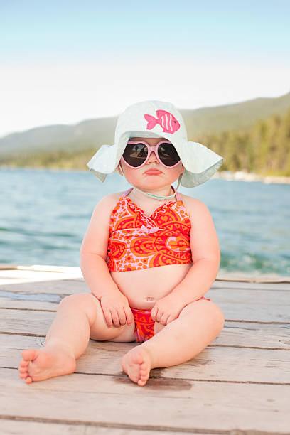 Pouting Beach Baby stock photo