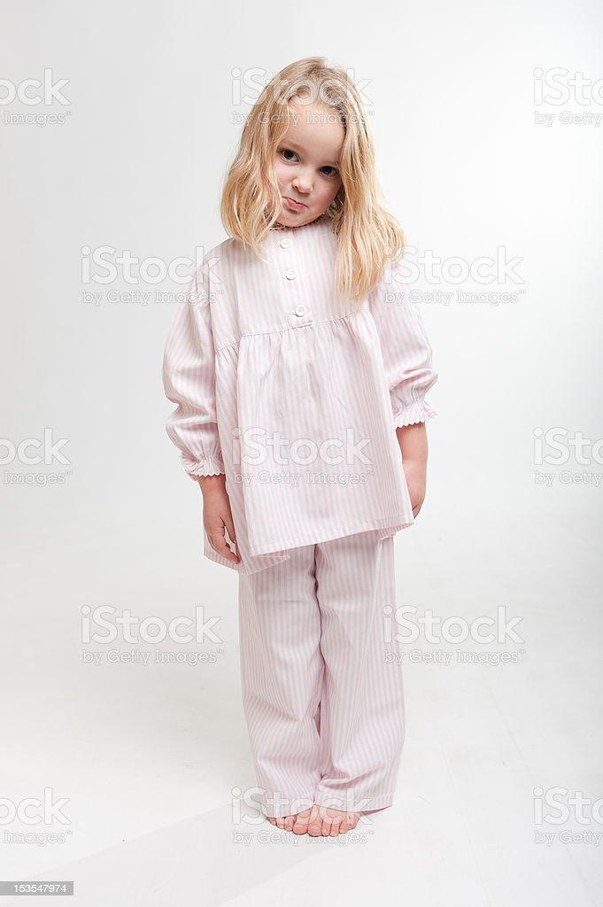 Pouting blonde kid in her pajamas royalty-free stock photo