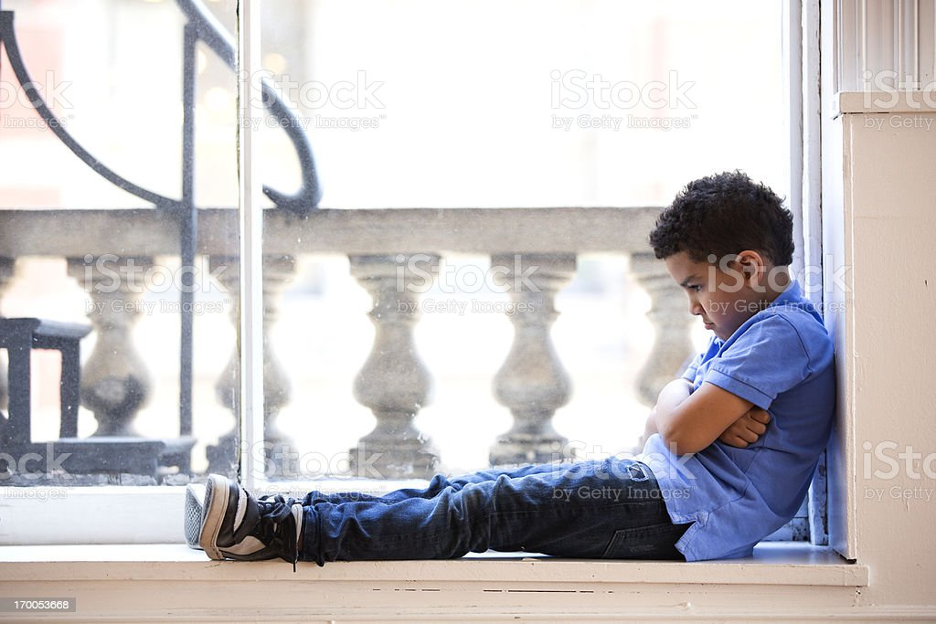 Pouting boy stock photo