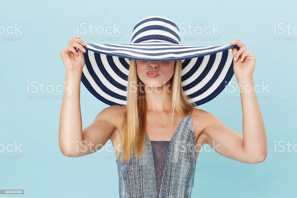 e4b23b96815e6 Pouting Young Lady In Summer Hat Stock Photo   More Pictures of 2015 ...