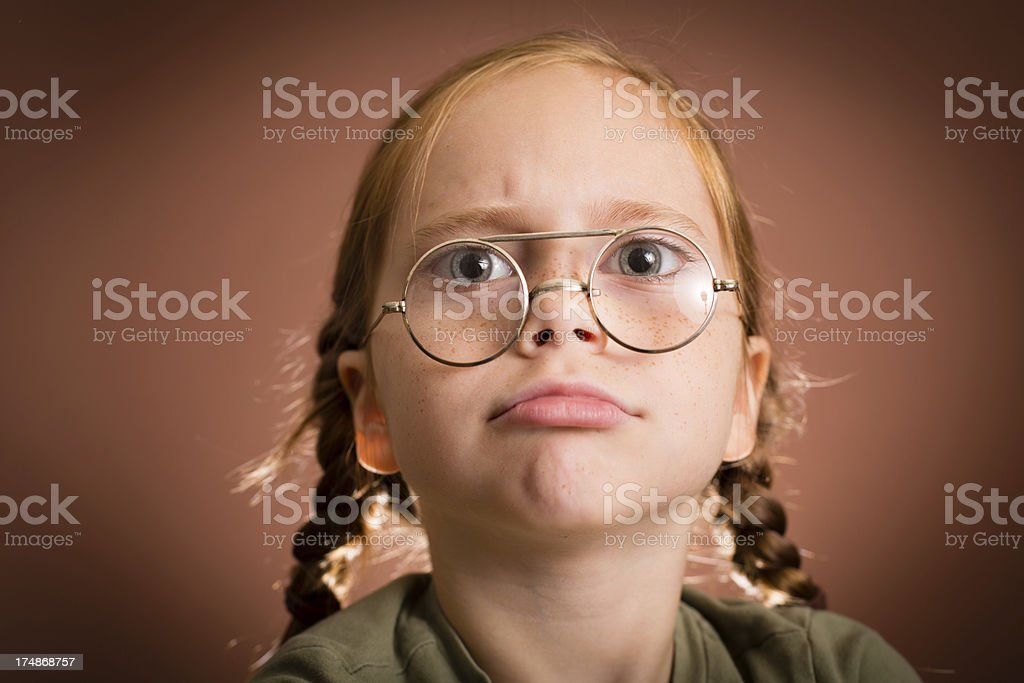 Pouty Little Girl Wearing Vintage, Nerdy Glasses royalty-free stock photo