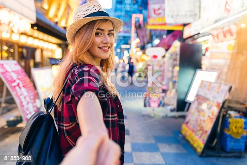 istock PoV of a couple exploring the streets of Japan at night 818534908