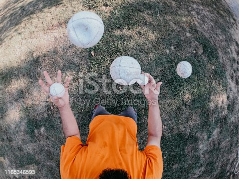 Pov view of a juggler performing at the park