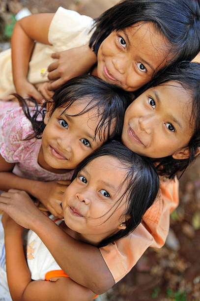 Poverty Children Group of happy poverty kids indonesian ethnicity stock pictures, royalty-free photos & images