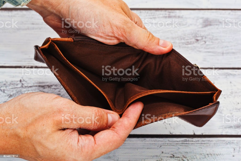 Poverty concept - empty wallet in hands stock photo