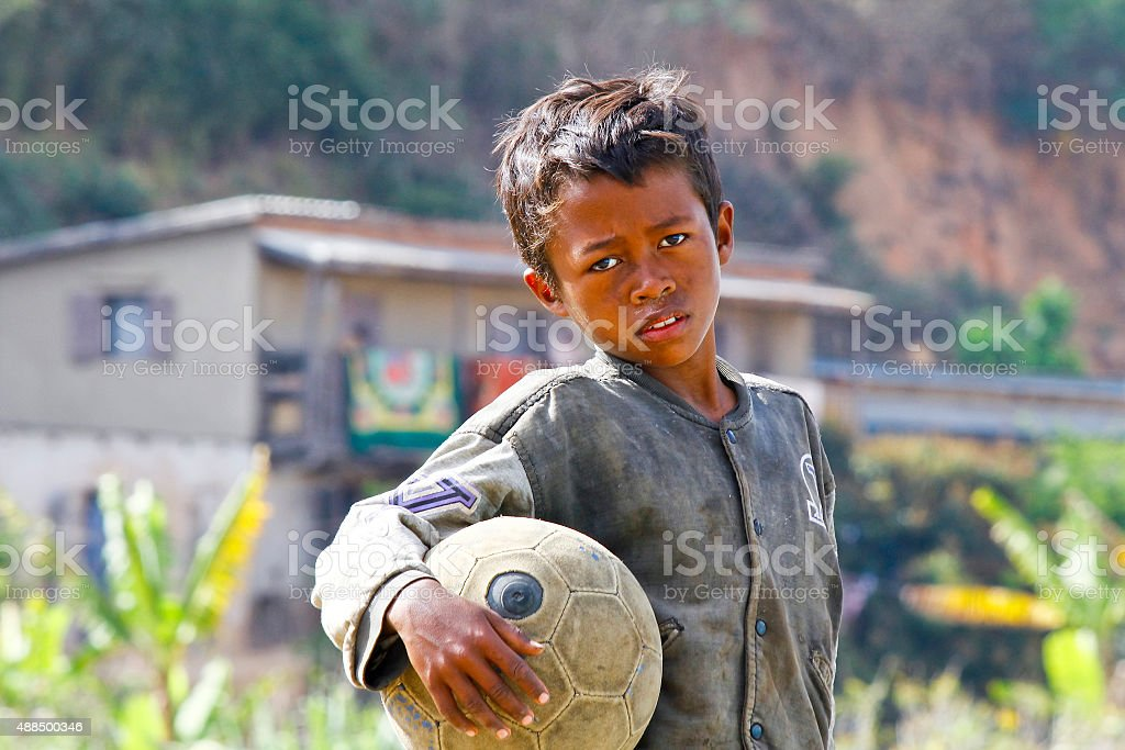 Poverty - Malagasy Boy Hand Holding Soccer Ball​​​ foto