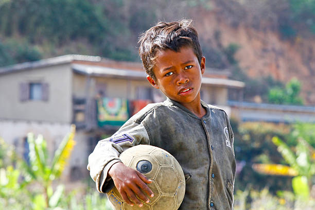 Poverty - Malagasy Boy Hand Holding Soccer Ball foto