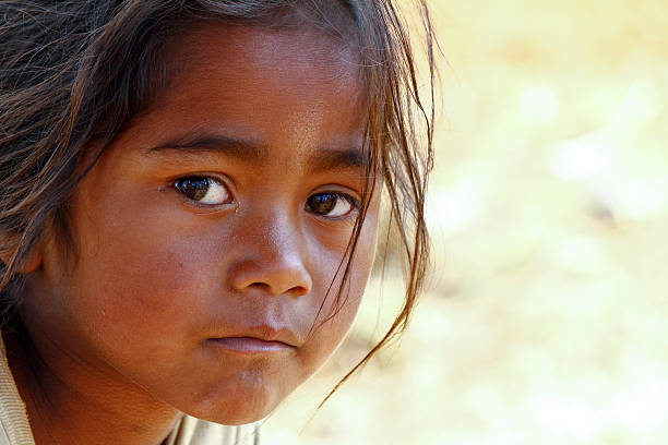 Poverty, portrait of a poor little African girl Poverty, portrait of a poor little African girl lost in deep thoughts illiteracy stock pictures, royalty-free photos & images