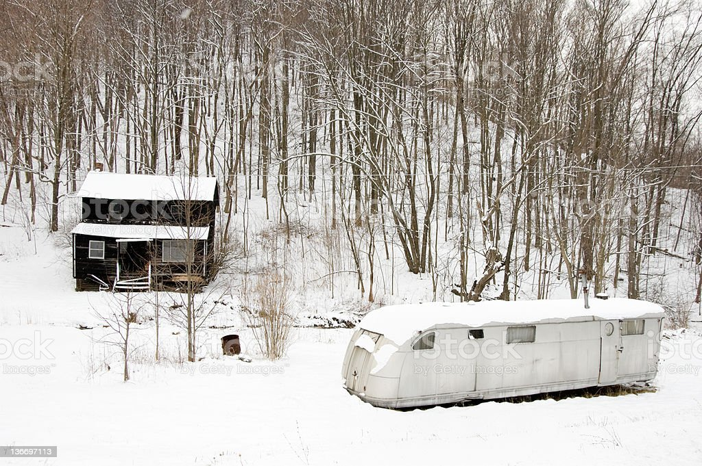 Poverty Shack and Silver Trailer Home in Appalachia America royalty-free stock photo