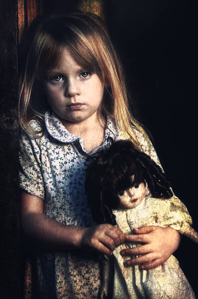 Poverty Stricken Little Girl Looking Sad stock photo