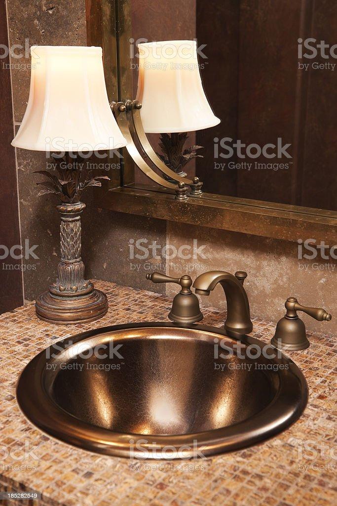 Powder bathroom with copper sink. stock photo