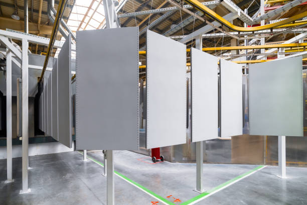 Powder coating line. Metal panels are suspended on an overhead conveyor line. stock photo