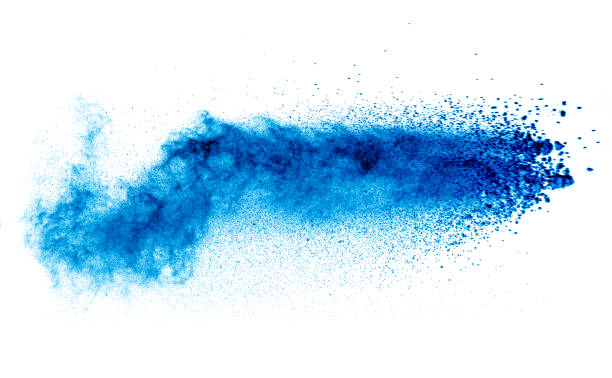 powder explosion isolated on white,motion blur - blue powder stock photos and pictures