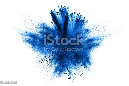 istock powder explosion.Powder explosion. Closeup of  blue dust particle explosion isolated on  background 880376320