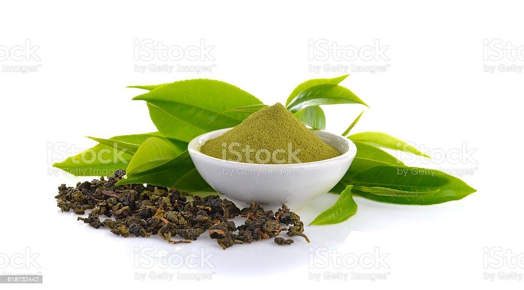 powder green tea and green tea leaf  on white stock photo