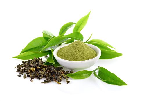 powder green tea and leaf  on white