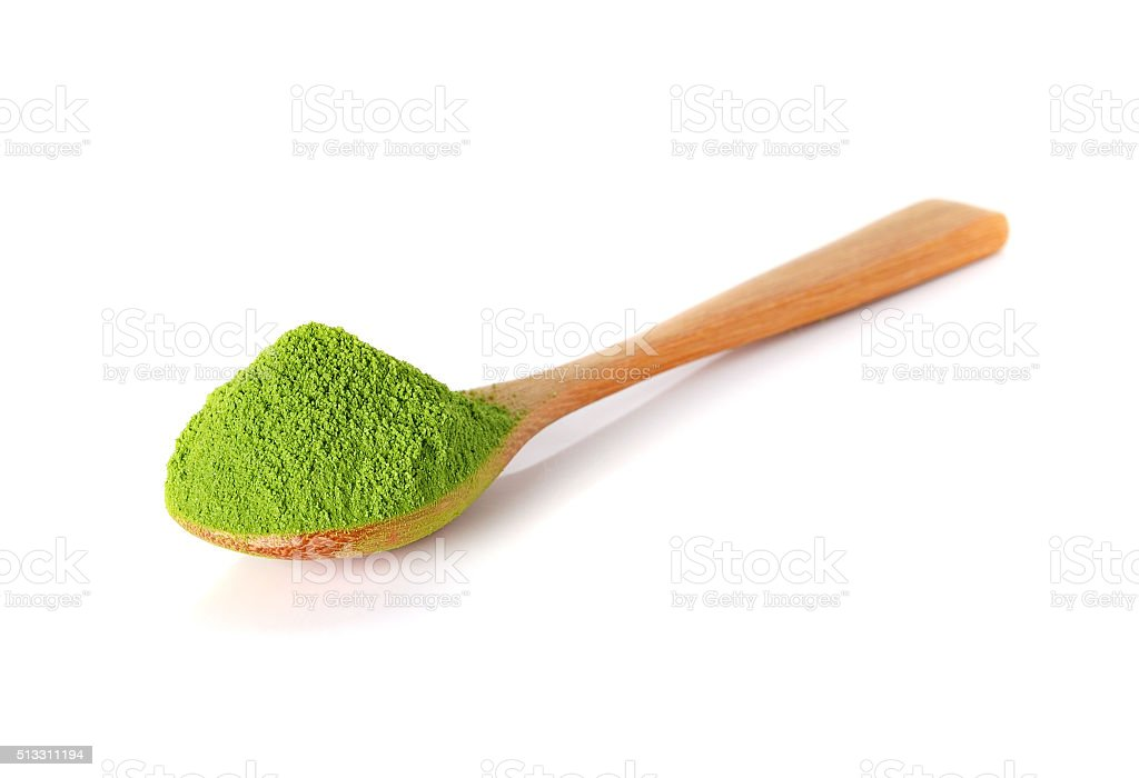 powder green tea with bamboo spoon isolated on white background stock photo