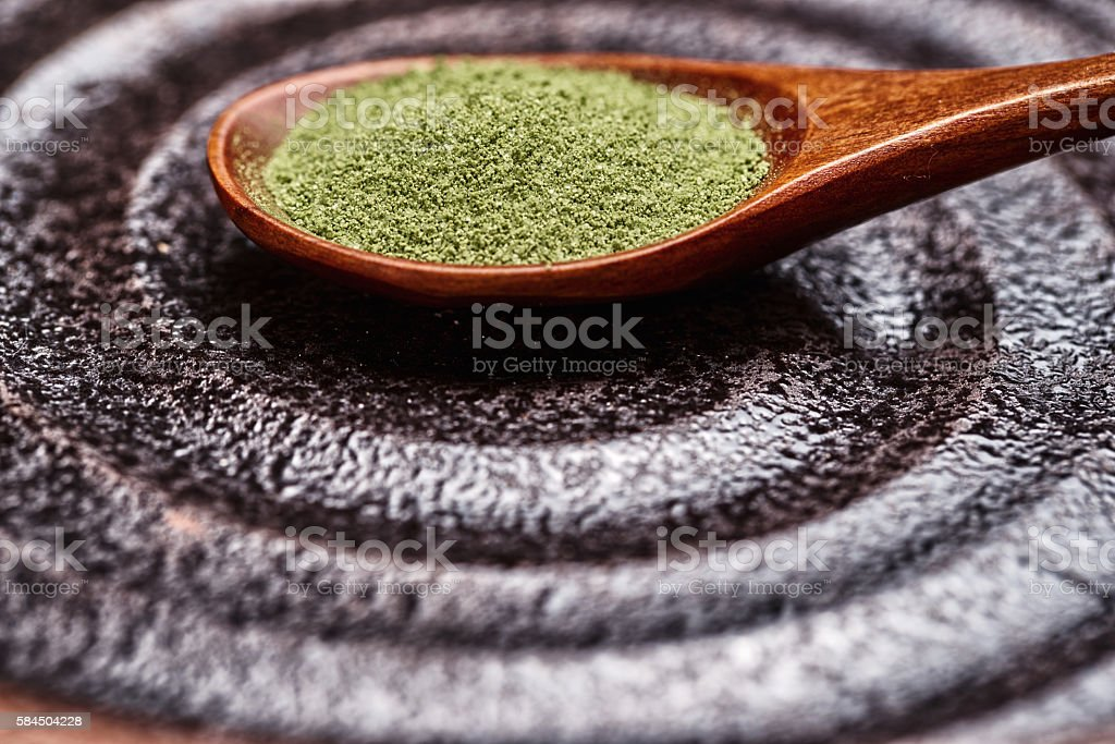 powder green tea with bamboo spoon stock photo