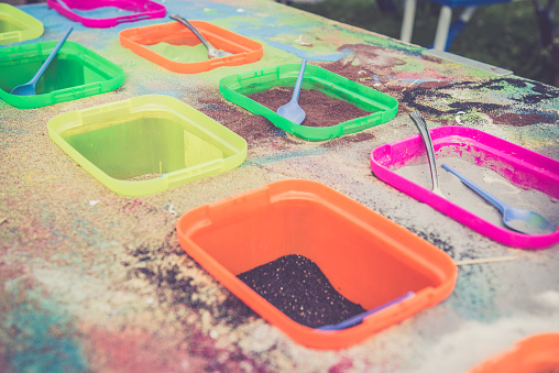 Color pigments in plastic containers on a table, Dubna, Russia. Nikon D800, full frame, XXXL: