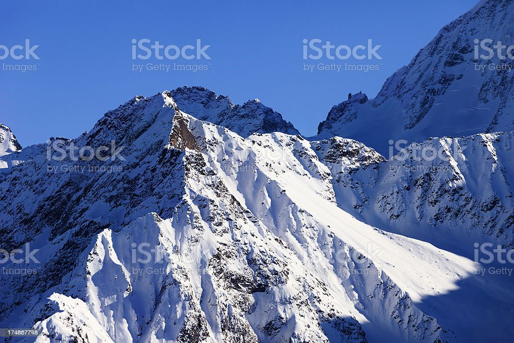 Powder snow at mountain peaks royalty-free stock photo