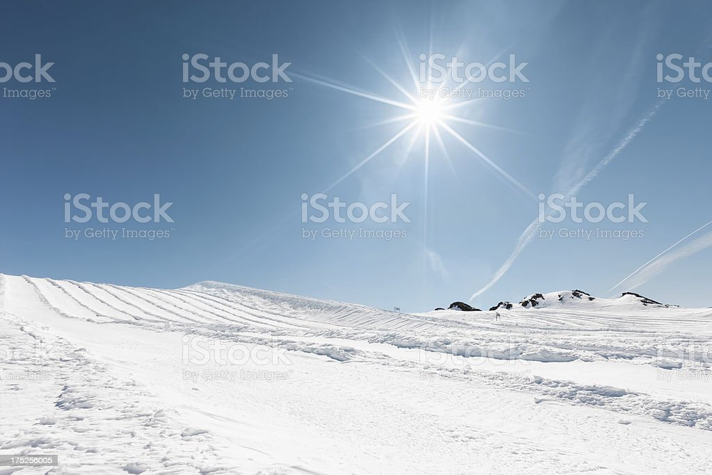 Powder snow at mountain peaks stock photo
