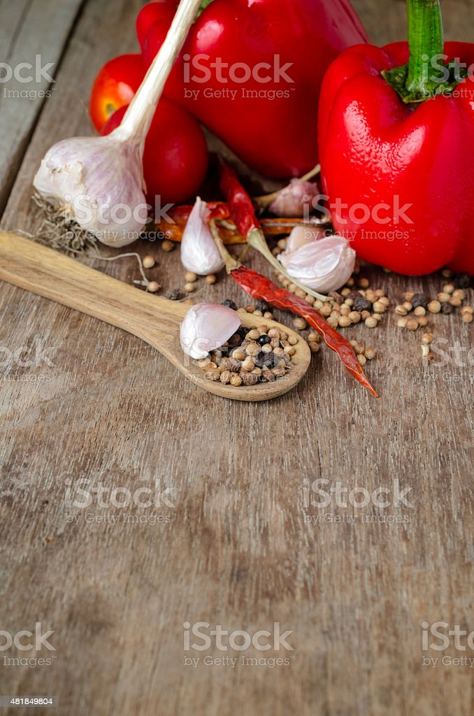 Powder spices on spoons in black wooden table background stock photo