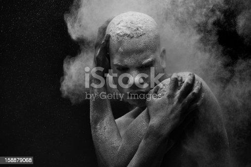 powder splashing on black male model