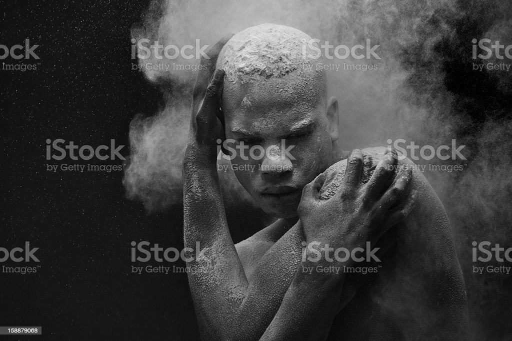 powder splashing on black male model stock photo