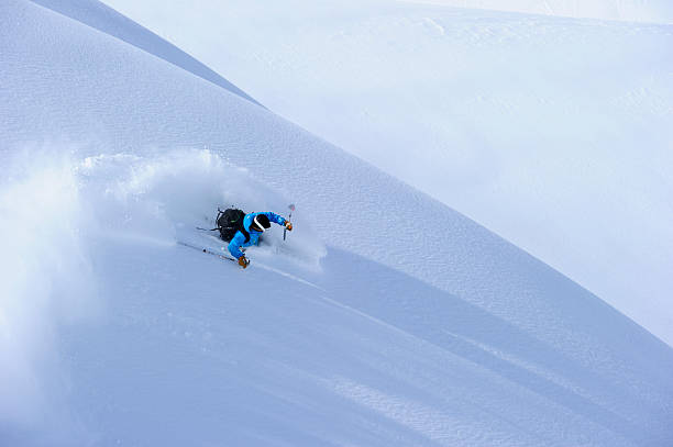 Powder Turn Skier making a turn in fluffy powder snow vail colorado stock pictures, royalty-free photos & images