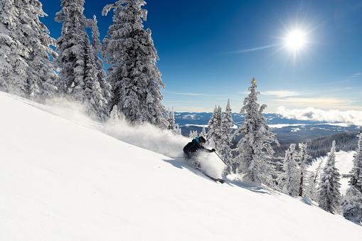 female skier on ski slope