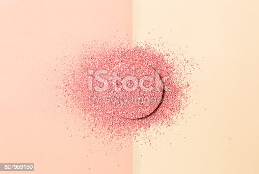 859783634 istock photo Powdered blush on a sponge on double background of pink and beige 827959150