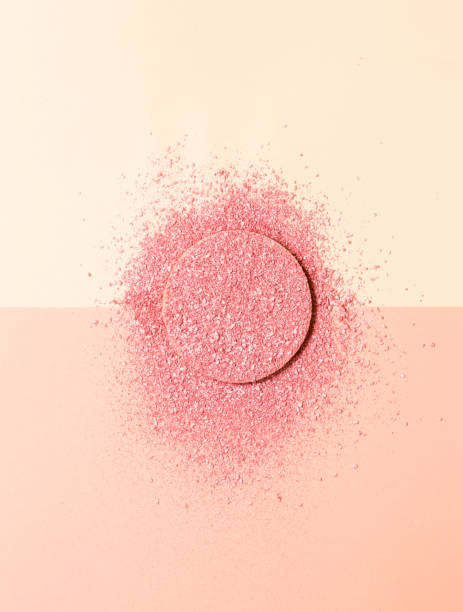 Powdered blush on a sponge on double background of pink and beige stock photo