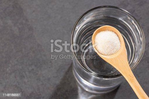 Powdered collagen protein. Glass of water