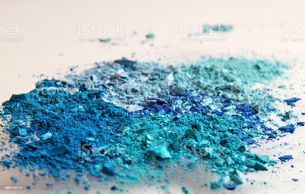 powdered eyeshadow in various shades of blues royalty-free stock photo